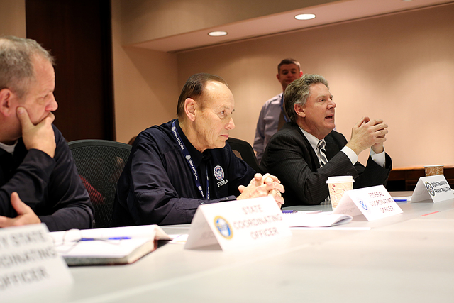 Lincroft, N.J., Jan. 7, 2013 -- FEMA Federal Coordinating Officer (FCO) Michael J. Hall (C) and Congressman Frank Pallone (L) attend a briefing at the Joint Field Office regarding the recovery efforts associated with hurricane Sandy. The Congressional Affairs Division is the Federal Emergency Management Agency's primary liaison with the United States Congress. Our mission is to proactively engage and communicate with Members of Congress and their staffs to build strong working relationships that will advance the agency's legislative and emergency management priorities. Adam DuBrowa/ FEMA