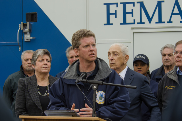 Lincroft, N.J., Nov. 16, 2012 -- Department of Housing and Urban Development Secretary Shaun Donovan speaks at a press conference concerning Hurricane Sandy recovery efforts, as Department of Homeland Security Secretary Napolitano and Senator   stand in the background. Photo by Liz Roll/FEMA