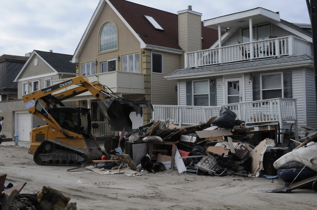Long Beach, N.Y., Nov. 14, 2012 -- debris removal begins in this Long Beach N.Y. neighborhood by contract workers who will be paid with FEMA Public Assistance funds. FEMA is here to help survivors recover from Hurricane Sandy.  George Armstrong/FEMA