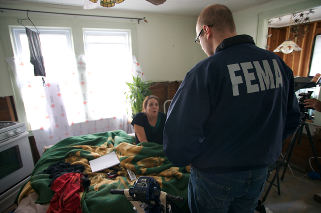 Long Beach, N.Y., Nov. 24, 2012 -- FEMA Branch I Deputy Operations Director, Robert Pesapane, talks with home owner about the FEMA STEP program and the benefits that she will be having by it. FEMA in conjunction with state, local and tribal partners, is implementing a Sheltering and Temporary Essential Power (STEP) Program to help people get back into their homes quickly and safely. STEP assists State, local and tribal governments in performing work and services essential to saving lives, protecting public health and safety, and protecting property. The program funds certain necessary and essential measures to help restore power, heat and hot water to primary residences that could regain power through necessary and essential repairs. STEP can help residents safely shelter-in-place in their homes pending more permanent repairs. FEMA is working with many partners including federal, state, local and tribal governments, voluntary faith-based and community-based organizations along with the private sector to assist residents impacted by Hurricane Sandy.  Eliud Echevarria/FEMA