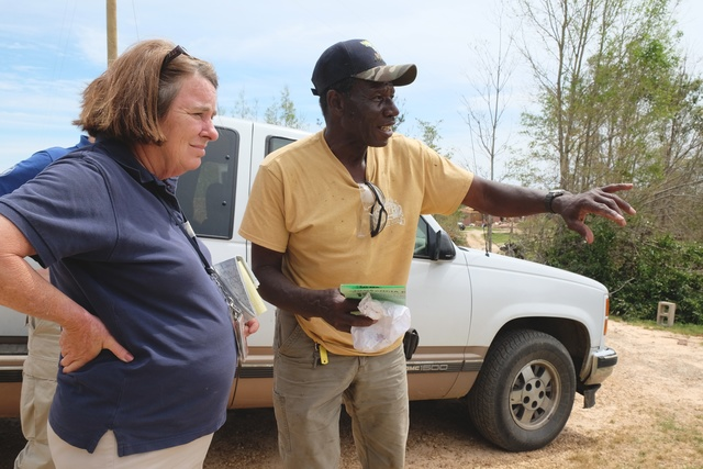 Louisville, Miss., May 8, 2014 -- Willie Robertson tells Mary Bartholomew of Mississippi Emergency Management Agency how he was lifted out of his living room and dropped on the ground on the other side of his yard. Survivors in Jones, Leake, Montgomery, Simpson and Warren counties whose property was damaged by the recent storms, tornadoes and flooding in Mississippi may now apply for federal assistance.  Bill Koplitz/FEMA