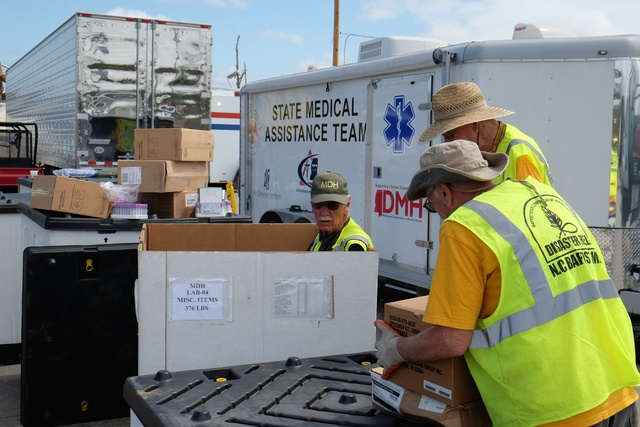 Louisville, Miss., May 9, 2014 -- Dr. Lew Stringer searches through a shipping box for hospital equipment with the North Carolina Baptist Men as they continue setting up the hospital on S. Church.  Survivors in Jones, Leake, Montgomery, Simpson and Warren counties whose property was damaged by the recent storms, tornadoes and flooding in Mississippi may now apply for federal assistance