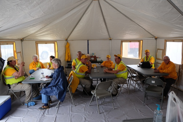 """""""Louisville, Miss., May 9, 2014 -- The North Carolina Baptist Men volunteers taking a brake in a tent set up as a break room.  They have been setting up the mobile hospital on S. Church Street. Residents in Itawamba, Jones, Leake, Montgomery, Simpson, Warren, Lee, Lowdnes, Madison, Wayne, Rankin and Winston counties whose property was damaged by the recent storms, tornadoes and flooding in Mississippi may now apply for federal assistance, and are encouraged to apply, to FEMA by calling (800) 621-3362, (TTY) (800) 462-7585, or by applying online at www.DisasterAssistance.gov. FEMA/Bill Koplitz"""""""