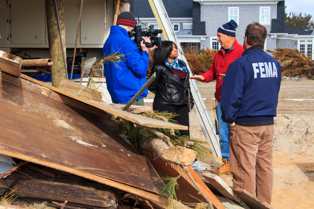 Mantoloking, N.J., Nov. 20, 2012 -- Ed Wright explains to a FEMA video crew, how his home was damaged but remained intact during Hurricane Sandy. FEMA's Federal Insurance and Mitigation Administration (FIMA) manages the National Flood Insurance Program (NFIP) and implements a variety of programs to reduce losses that may result from natural disasters. Steve Zumwalt/FEMA