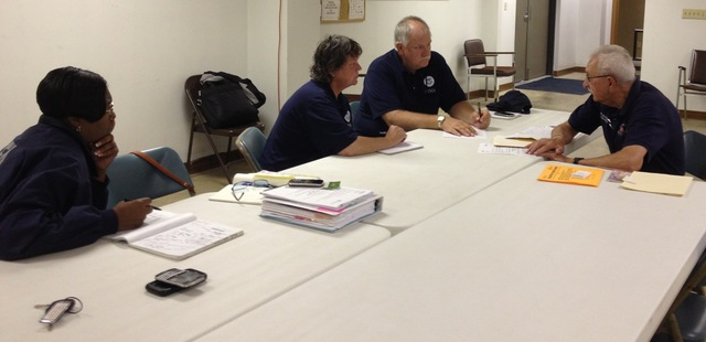 McNabb, Ill., July 9, 2013 --Putnam County Emergency Manager James Goldasich, right, discusses community outreach with FEMA staff members Richard Gomes, Karen Nelson and Kesha Waites. FEMA works closely with local and state partners to provide assistance to disaster survivors