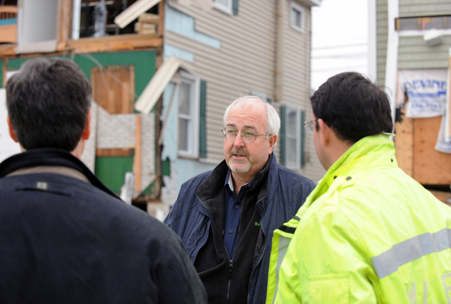 Milford, Conn., Nov. 27, 2012 -- FEMA Administrator Craig Fugate talks to local officials during a tour of a neighborhood  impacted by Hurricane Sandy.  The Administrator also visited local Disaster Recovery Centers throughout the area.  Jocelyn Augustino/FEMA
