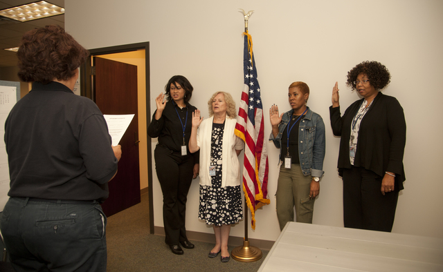 Montgomery, Ala., June 16, 2014 -- Deputy Federal Coordinating Officer, Rosaln Cole swears in new local hires at the Joint Field office (JFO) in Montgomery, Ala. From left to right Rachel Bane, Public Assistance; Iris Moebius, VAL; Alisha Smith, Planing and Zia Elston, EHO.  Patsy Lynch/FEMA