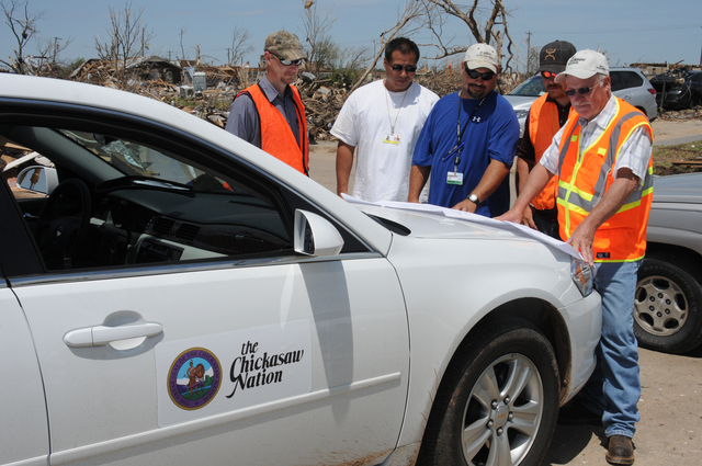 Moore, Okla., June 3, 2013 -- Chickasaw Nation Fire Marshall Dewayne Price(R), Brandon Prine, John McKay, Wade Whittington, and Wendell Camp refer to a map while here to help citizens and employees of the Chickasaw Nation who live in this area, clean May 20 tornado debris from their property.  George Armstrong/FEMA