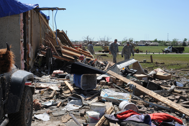 Moore, Okla., May 22, 2013 -- Military personnel are helping a fellow unit member recover possessions and clean up debris after the May 20 tornado. President Obama signed an expedited Presidential declaration on May 21 and FEMA services are now available for eligible survivors. George Armstrong/FEMA