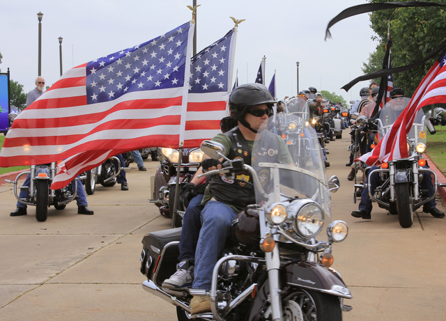 Moore, Okla., May 23, 2013 -- Patriot Guard Riders participated in a mass ride in support of the families who lost loved ones to the May 20 tornado.  President Obama declared the area a federal disaster and FEMA is providing assistance to affected individuals and families.  FEMA/Judith Grafe