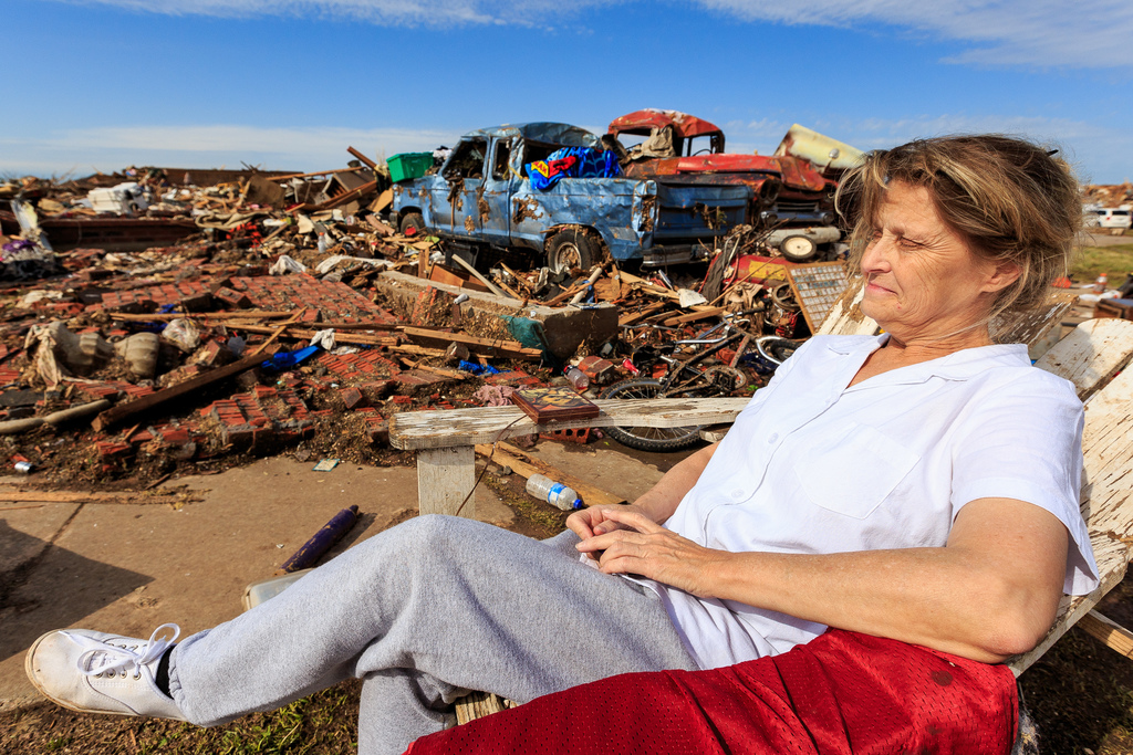 Moore, Okla., May 23, 2013 -- Sandra Simmons takes a break from going through the debris of her home of 20 years which was flatten by a tornado on May 20, 2013. FEMA is working to provide assistance to people affected by the storm. Steve Zumwalt/FEMA