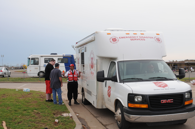 Moore, Okla., May 23, 2013 -- This Salvation Army vehicle is in the May 20 tornado disaster scene to provide snacks and beverages to storm survivors who are cleaning up debris and searching for possessions. Voluntary agencies provide much needed personal services and are important FEMA partners in disaster recovery.  George Armstrong/FEMA