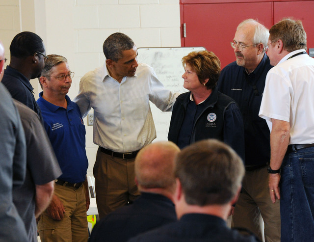 Moore, Okla., May 26, 2013 -- President Barack Obama, center, speaks with FEMA Federal Coordinating Officer Sandy Coachman, to his right, and  first responders at Fire Department Station 1, after getting a first hand look at a neighborhood impacted by the recent F5 tornado. FEMA Administrator Craig Fugate, second from left, joined President  Obama for the visit.Jocelyn Augustino/FEMA