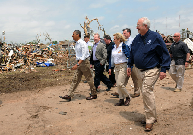 Moore, Okla., May 26, 2013 -- President Barack Obama, second from left, and  FEMA Administrator Craig Fugate,right, tour a neighborhood impacted by the recent F5 tornado.  They were joined by local and state elected officials.Jocelyn Augustino/FEMA