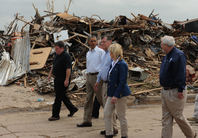 Moore, Okla., May 26, 2013 -- President Barack Obama, second from left, and  FEMA Administrator Craig Fugate, right, tour a neighborhood impacted by the recent F5 tornado.  They were joined by local and state elected officials.Jocelyn Augustino/FEMA