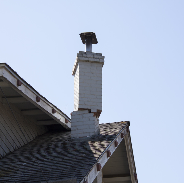 Napa, Calif., August 24, 2014 -- The earthquake that shook Napa, Calif., took its toll on the brick chimneys in the city, leaving precarious situations like this one