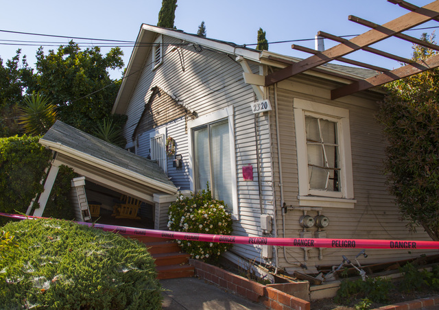 Napa, Calif., August 24, 2014 -- This house suffered severe damage after an earthquake shook up Napa, California. Building inspectors are going door to door assessing damage done to homes and businesses in the city to ensure that residents stay safe from falling debris and unstable structures