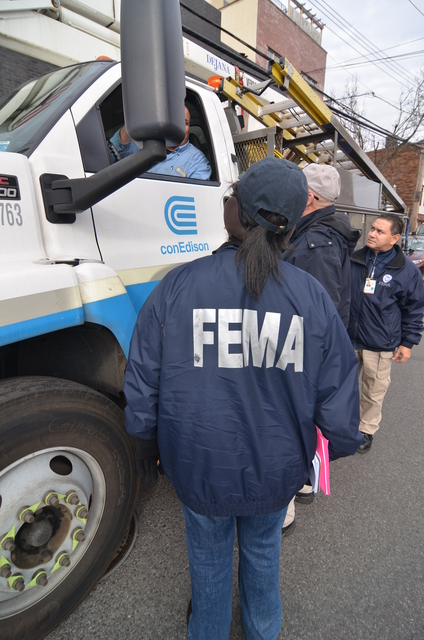 New York City, N.Y., Dec. 11, 2012 --  FEMA Community Relations employees discuss the restoration of electric service in the Red Hook area of Brooklyn with employees of NYC's Con Edison electric company.  The repair of old electrical infrastructure in the New York City area has frustrated residents and business people in the aftermath of Hurricane Sandy.  Walt Jennings/FEMA
