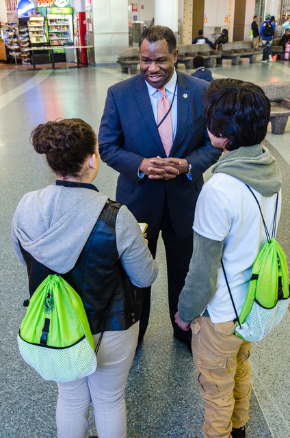 New York, N.Y., April 30, 2014 -- FEMA Region II Administrator Jerome Hatfield meets with students from the Urban Assembly School for Emergency Management. The students are at the Staten Island Ferry Terminal to survey commuters on disaster preparedness. K.C.Wilsey/FEMA