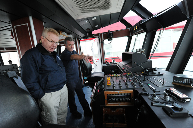 New York, N.Y., Dec. 1, 2012 -- Federal Coordinating Officer Michael Byrne, left, gets a tour of Marine 9 Fire Boat II from Fire fighter Brian Masterson.  The fire boat, which serves all of New York Harbor, is docked at the FDNY Marine 9 Barracks at the former Navy Homeport site in Stapleton, Staten Island. The fireboat received some damage from the storm surge following Hurricane Sandy.  Jocelyn Augustino/FEMA