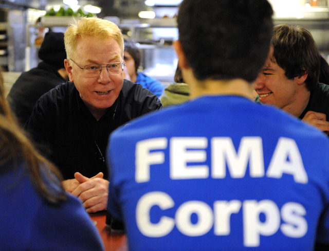 New York, N.Y., Dec. 1, 2012 -- Federal Coordinating Officer Michael Byrne, left, talks to FEMA Corps members aboard the Training Ship Empire State VI, docked on the East River at the foot of the Throgs Neck Bridge.  The ship has provided accommodations for volunteers from FEMA Corps and Federal Surge groups who have come to assist in the recovery efforts for Hurricane Sandy.  Jocelyn Augustino/FEMA