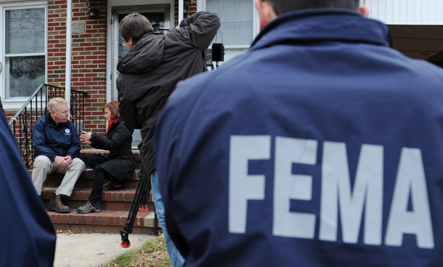 New York, N.Y., Dec. 1, 2012 -- Federal Coordinating Officer Michael Byrne, left, talks to CNN reporter Susan Candiotti outside of the house of Vincent Ribaudo of Grant City.  Ribaudo was receiving   assistance with electrical repairs by the STEP program.  FEMA designed, in the immediate aftermath of Hurricane Sandy, the Sheltering and Temporary Essential Power (STEP) Pilot Program to assist State, local and Tribal governments in performing work and services essential to saving lives, protecting public health and safety, and protecting property. In particular, FEMA intends STEP to provide essential power to affected residences, thereby reducing the demand for other shelter options and allowing individuals to return to or remain in their home.   Jocelyn Augustino/FEMA