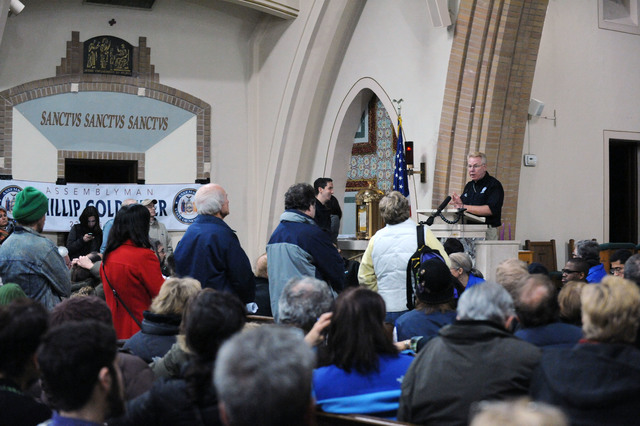 New York, N.Y., Dec. 5, 2012 -- Federal Coordinating Officer, Michael Byrne, at podium, addresses members of the community at St. Francis de Sales in the Rockaways.  The town hall meeting was moderated by Assemblyman Phil Goldfeder and had state, local and federal representatives to discuss the concerns of residents impacted by Hurricane Sandy.  Jocelyn Augustino/FEMA