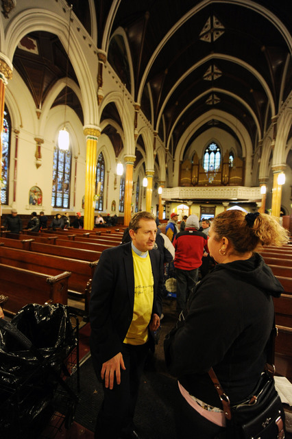 New York, N.Y., Dec. 9, 2012 -- Local residents talk to Father Claudio Antecini, the priest at Visitation of the Blessed Virgin Mary Roman Catholic Church, during a donation and distribution drive  that he set up for Spanish-speaking members of his congregation.  FEMA community relations members were onsite to help residents who have not applied for assistance and were encouraged to do so if they have not yet applied for assistance.  Jocelyn Augustino/FEMA