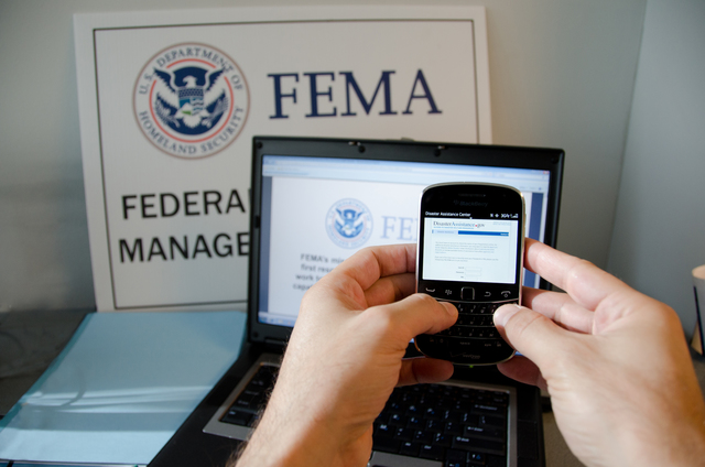 New York, N.Y., Jan. 23, 2013 -- A disaster survivor is registering for assistance on their Blackberry smartphone using disasterassistance.gov. Andrea Booher/FEMA
