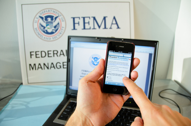 New York, N.Y., Jan. 23, 2013 -- A disaster survivor is registering for assistance on their Apple smartphone using disasterassistance.gov. Andre R. Aragon/FEMA