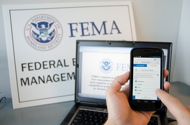 New York, N.Y., Jan. 23, 2013 -- A disaster survivor is registering for assistance on their Android smartphone using disasterassistance.gov. Andrea Booher/FEMA