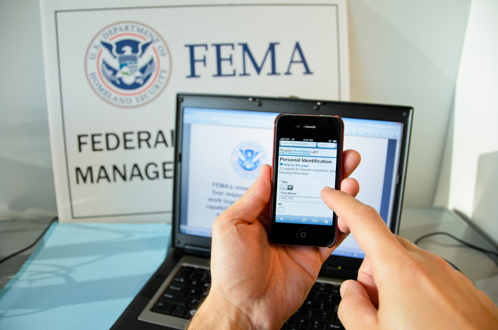 New York, N.Y., Jan. 23, 2013 -- A disaster survivor is registering for assistance on their Apple smartphone using disasterassistance.gov. Andre R. Aragon/FEMA
