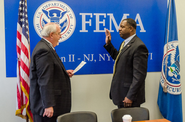 New York, N.Y., November 5, 2013 -- FEMA Administrator Craig Fugate administers the oath of office to Lieutenant Colonel Jerome Hatfield who will take over as the new Regional Administrator for Region II. K.C.Wilsey/FEMA
