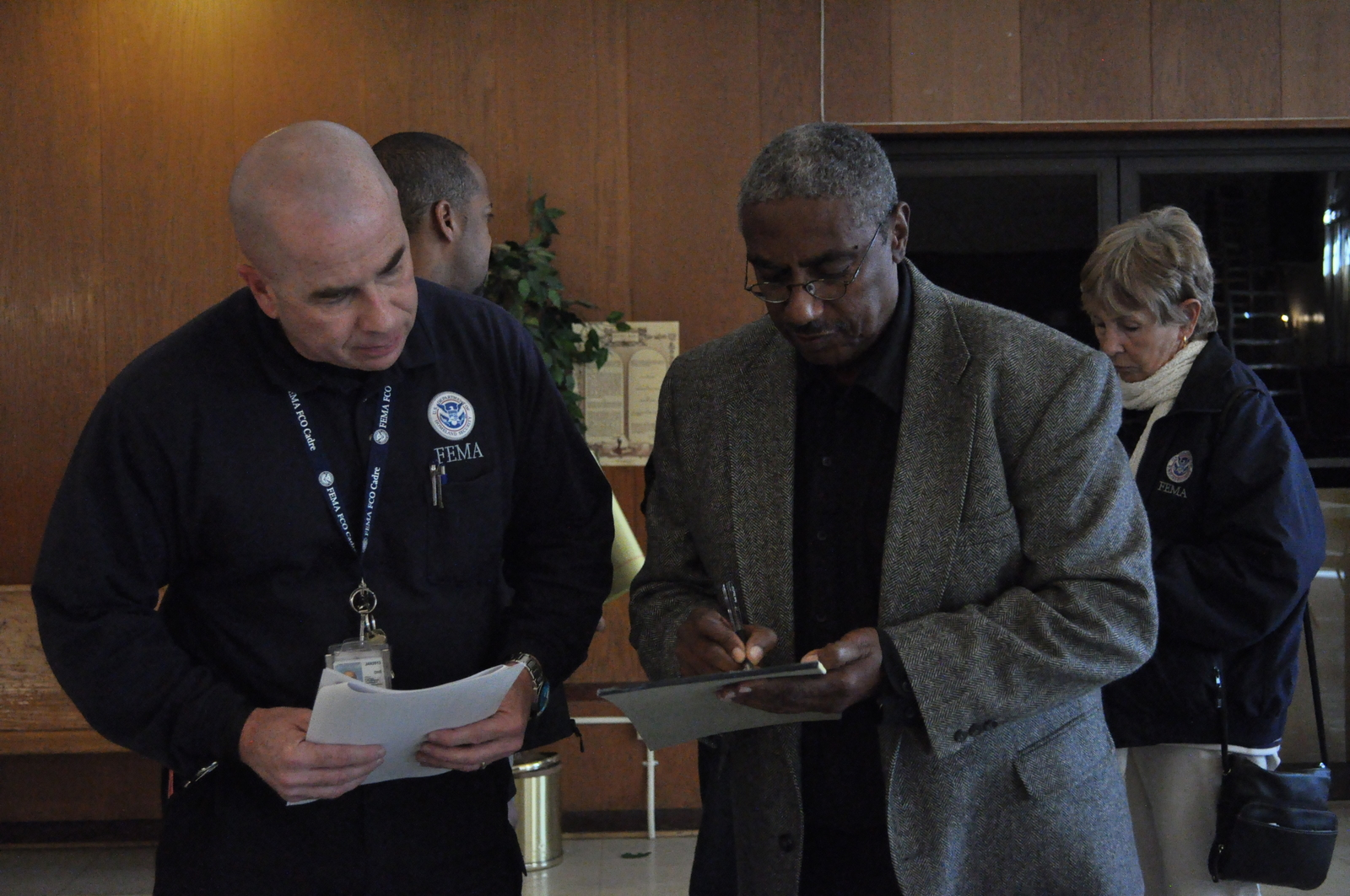 Newark, N.J., Nov. 5, 2012 -- Federal Coordinating Officer, Joe Girot, exchanges information with Pastor Norman Miles of Trinity Temple in preparation for a meeting with local area pastors. The meeting was arranged to discuss the best ways to help members of the community deal with the aftermath of Hurricane Sandy. Photo by Sharon Karr/FEMA