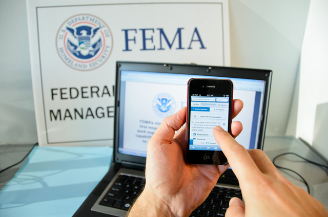 N.Y., Jan. 23, 2013 -- A disaster survivor is registering for assistance on their Apple smartphone using disasterassistance.gov. Andre R. Aragon/FEMA