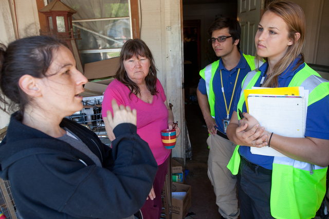 Pensacola, FL, May 15, 2014 -- FEMA's Disaster Survivor Assistance Team (DSAT) members, Marie Orechoff and Roger King listen to flood survivor, Katerina Penergast as she describes the damages to her home in Brownsville. After major flash flooding along parts of the Florida Panhandle, the DSAT teams were deployed to go door to door and check on the welfare of disaster survivors. Andrea Booher/FEMA