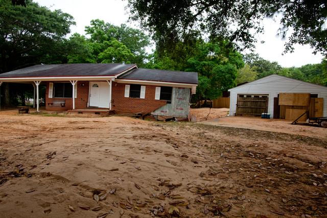 Pensacola, Fla., May 10, 2014 -- Flash flood damage to home in Crescent Lake, neighborhood of Pensacola. Andrea Booher/FEMA