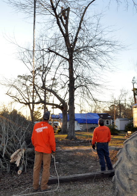 Petal, Miss., Feb. 17, 2013 -- Samaritan's Purse volunteers work late in Forrest County, especially teams that include professional tree surgeons. Volunteers are an essential workforce in the recovery effort, working tirelessly in the cleanup.  Photo by Marilee Caliendo/FEMA