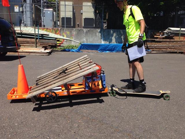 Portland, Ore., July 19, 2014 ; Corey Poole, a participant in the Disaster Relief Trials, created a small trailer to attach to his skateboard, his primary mode of transportation. This event required participants to navigate a 30+ mile route and transport more than 100lbs of supplies