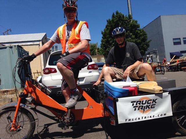 Portland, Ore., July 19, 2014 ; These brothers use teamwork to gather and transport 100lbs of disaster supplies at the Portland Disaster Relief Trials