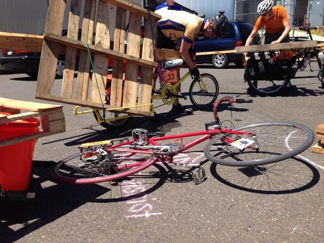 Portland, Ore., July 19, 2014 ; These two riders fasten huge pieces of lumber to their cargo bikes at the FEMA checkpoint at the Disaster Relief Trials. At this checkpoint, rider must take large pieces of lumber, fill out a mini emergency communication plan, and collect a disaster wheel spoke card before advancing to the next checkpoint