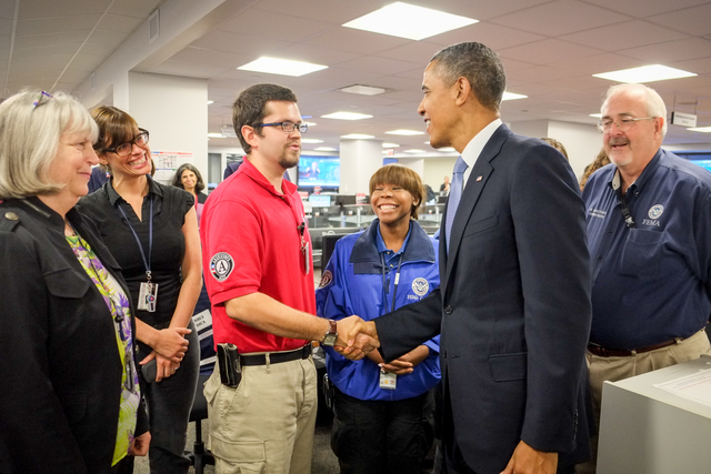 President Barack Obama thanks Matt Labbe, FEMA Corps Team Leader (AmeriCorps NCCC - Spruce 5) while visiting the FEMA National Response Coordination Center (NRCC) at FEMA Headquarters in Washington, DC.  President Obama visited the NRCC on October 7, 2013, to thank FEMA employees for their ongoing dedication and service during the lapse in government appropriations.  FEMA Corps, a partnership between FEMA and the Corporation for National and Community Service, is designed to strengthen the nation's ability to respond to and recover from disasters while expanding career opportunities for young people serving in AmeriCorps