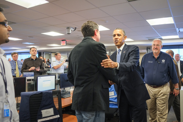 President Barack Obama thanks Shayne Adamski, FEMA's Senior Manager of Digital Engagement, while visiting the FEMA National Response Coordination Center (NRCC) at FEMA Headquarters in Washington, DC.  President Obama visited the NRCC on October 7, 2013, to thank FEMA employees for their ongoing dedication and service during the lapse in government appropriations