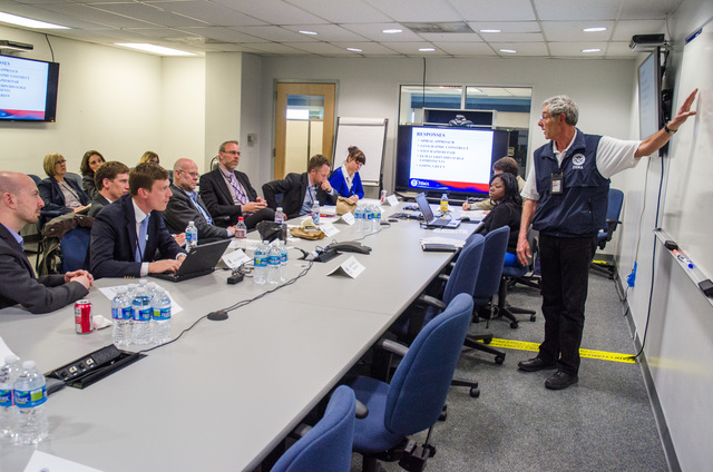 Queens, N.Y., April 25, 2013 --FEMA hosted municipal and emergency management officials from Stockholm, Sweden at the NY Joint Field Office (JFO) to brief them on disaster recovery operations for Hurricane Sandy. Park Owens, FEMA Operations Section Chief, discusses different aspects of the response. K.C.Wilsey/FEMA