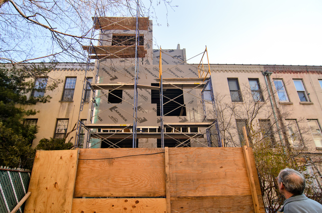 Queens, N.Y., Jan. 8, 2013 -- Architect Thomas Paino of Long Island City, NY, elevates 3 floors of his row house to move the basement level out of the floodplain. In addition, the house has benefited from the work of structural engineers and sustainability architects who are making major energy efficiency modifications. Andre R. Aragon/FEMA