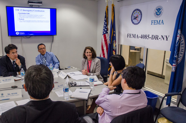 Queens, N.Y., May 30, 2013 -- FEMA welcomed government officials, from the Republic of Singapore, the Republic of Korea, and the United Kingdom, as well as Fellows from the Brookings Institution, to the NY Joint Field Office (JFO) to brief them on disaster recovery procedures for Hurricane Sandy. External Affairs Officer, Crystal Payton, discussed FEMA's multifaceted approach to providing information to the public throughout the disaster cycle. K.C.Wilsey/FEMA