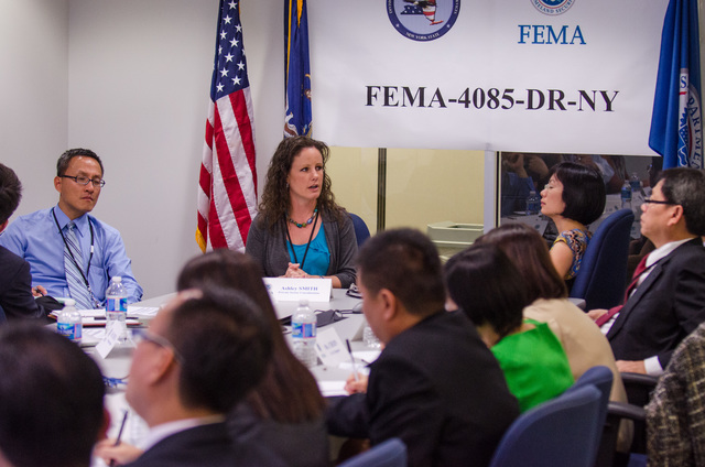 Queens, N.Y., May 30, 2013 -- FEMA welcomed government officials, from the Republic of Singapore, the Republic of Korea, and the United Kingdom, as well as Fellows from the Brookings Institution, to the NY Joint Field Office (JFO) to brief them on disaster recovery procedures for Hurricane Sandy. Ashley Smith, Assistant External Affairs Officer (Private Sector), discussed the role FEMA and Private Sector partnerships play in the response and recovery to disasters. K.C.Wilsey/FEMA