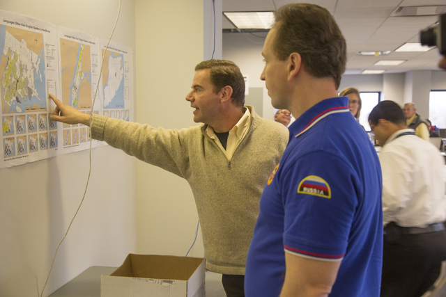 Queens, N.Y., Nov. 15, 2012 -- Eric Phillipson, FEMA Planning Liaison, points to and reviews a disaster map with Alexander Romanov, Director of Federal-State Russian Airmobile Rescue Service, Moscow, during a tour of FEMA's DR-4085 Joint Field Office (JFO) in Queens, New York. Following the onslaught of Hurricane Sandy, FEMA coordinates its work in New York at the FEMA JFO in Queens and supports state, local, tribal and volunteer agencies in their disaster response activities. FEMA also welcomes the cooperation and assistance of international experts such as the Russian Airmobile Rescue Service who are familiar with disaster response techniques needed to assist communities in need of relief.  Photo by Christopher Mardorf/FEMA