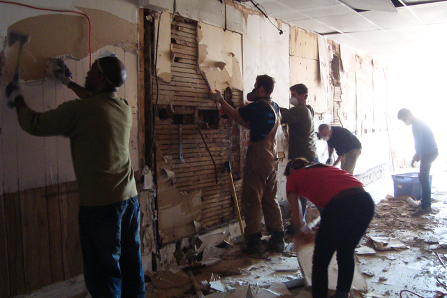 Rockaway, N.Y., Nov. 11, 2012 -- Volunteers from Occupy Sandy are taking out drywalls that were damaged due to Hurricane Sandy. FEMA plays a vital role supporting State, Tribal and local governments as they respond to the impacts of Hurricane Sandy. Photo by Elissa Jun/FEMA