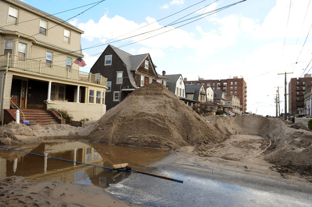 Rockaway, N.Y., Nov. 3, 2012 -- Piles of sand are stacked outside of resident's houses as they continue to cleanup.  Hurricane Sandy brought lots of sand and water in to neighborhoods bordering the shore.  Jocelyn Augustino